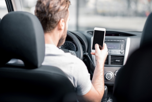 Man Using Phone in Car