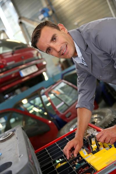 Man Getting Car Parts