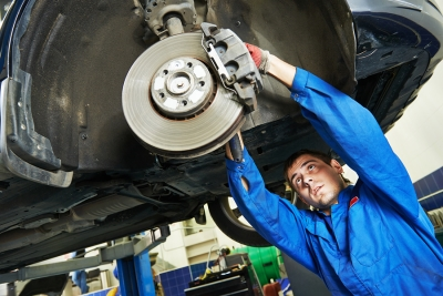 Mechanic Fixing Car Brakes